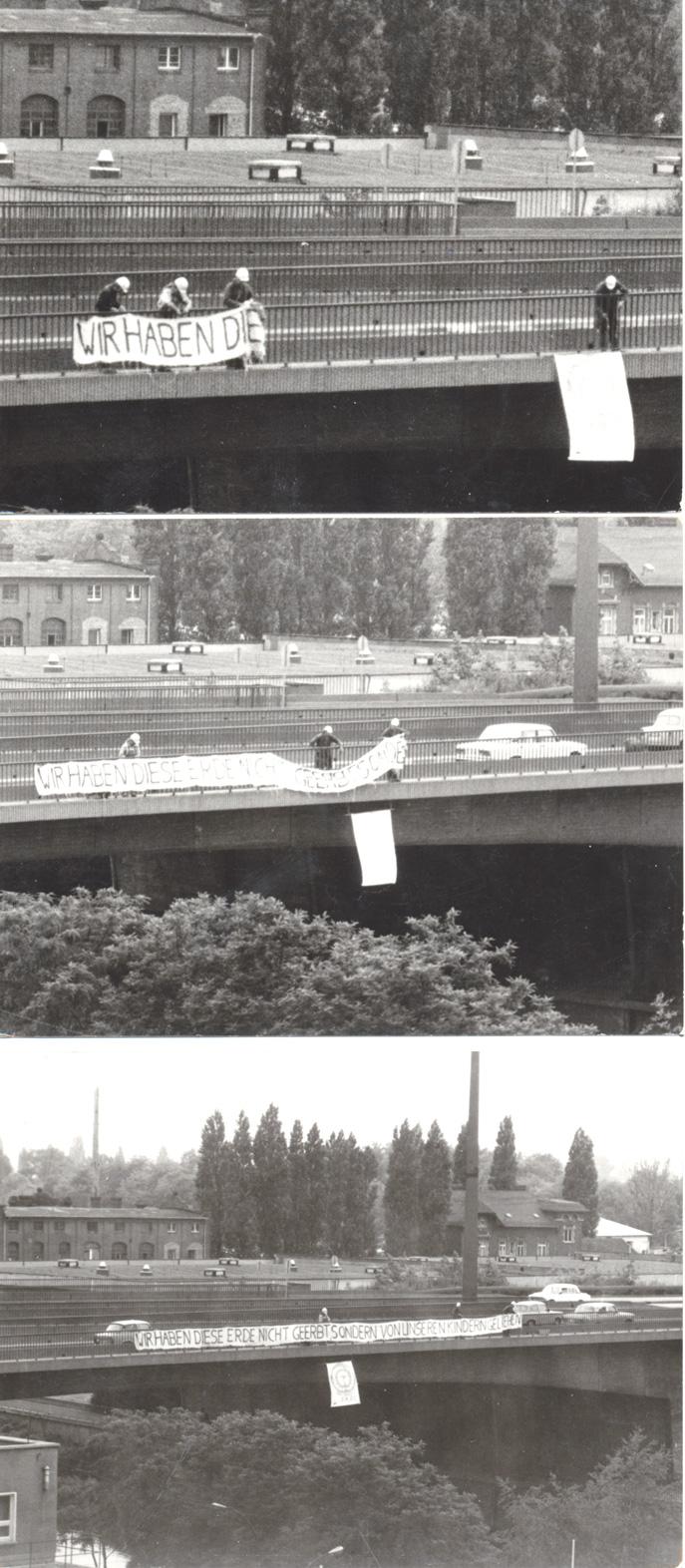 """Zur gleichen Zeit hängt eine zweite Gruppe, als Bauarbeiter getarnt, ein über 30 Meter langes Transparent an der Mansfelder Brücke auf. """"Wir haben die Erde nicht geerbt, sondern nur von unseren Kindern geliehen"""" prangt dort in großen Lettern. (Fotos: Andreas Baumgartner)."""